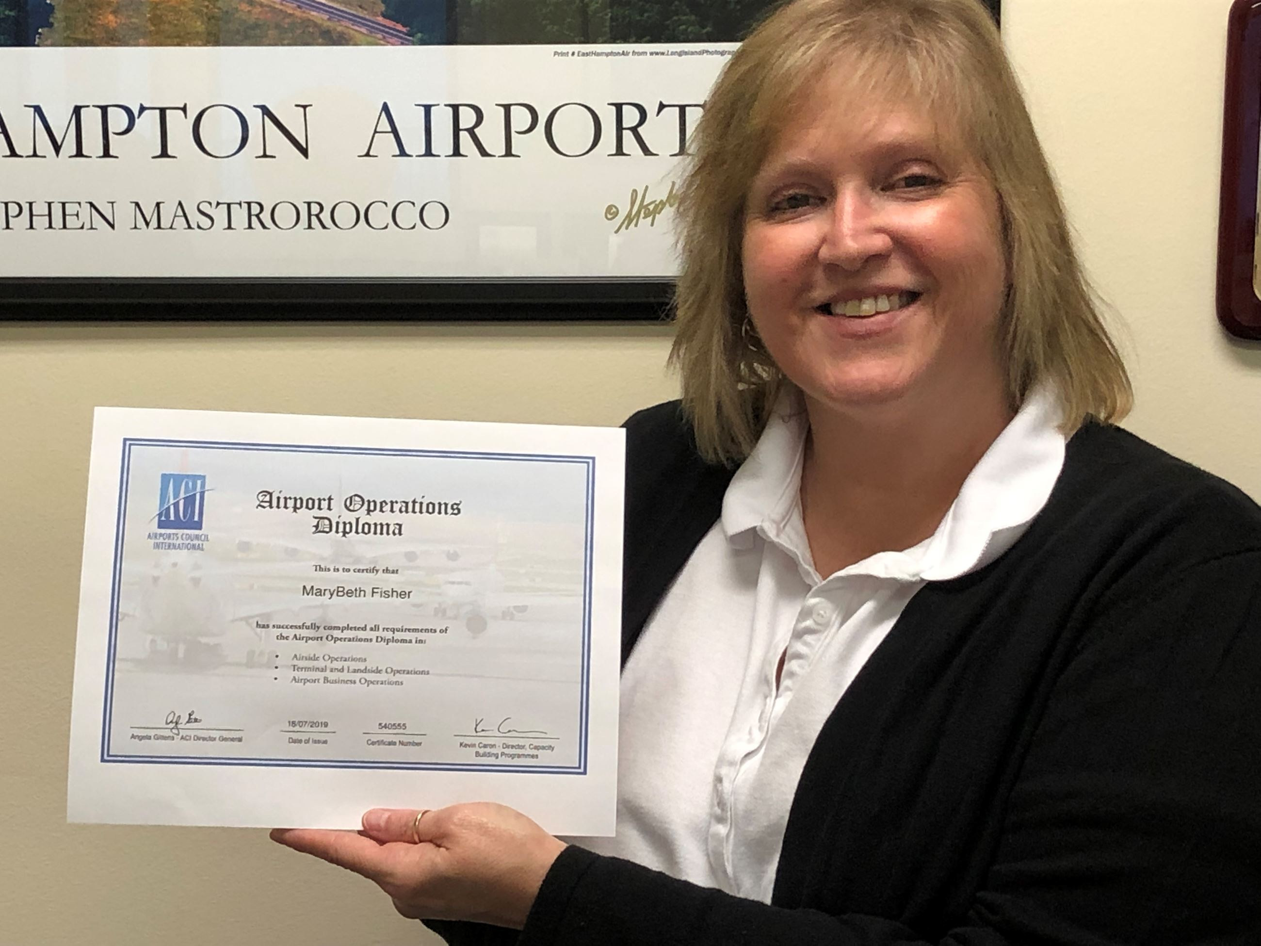 Mary Beth with diploma airport